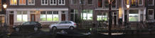 2018 - When The Cows Come Home - A video loop of a herd of cows walking toward the center of Amsterdam behind the windows of five canal houses - Jaap de Ruig